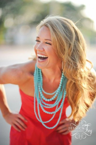 red dress and turquoise necklace