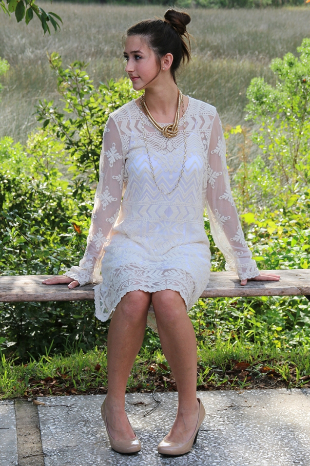 Victorian lace shift dress with layered gold necklaces