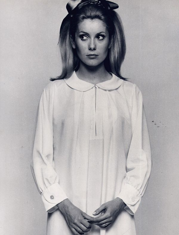 Catherine Deneuve in Peter Pan Collar Dress with a Bow in her hair