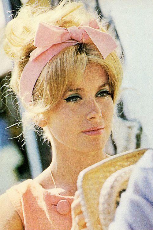 Catherine Deneuve Hair Style with Pink Bow Headband